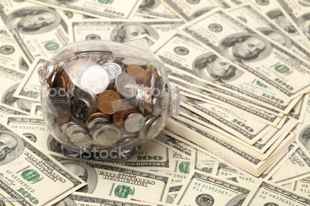 piggy bank on dollars stock photo