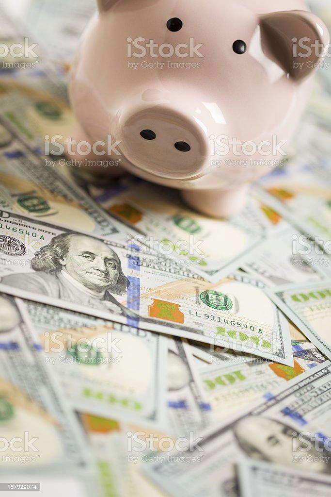 Piggy Bank on Newly Designed One Hundred Dollar Bills stock photo