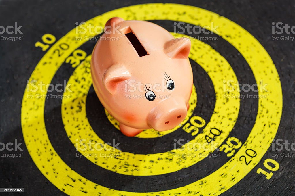 Piggy Bank on Old Target Board stock photo