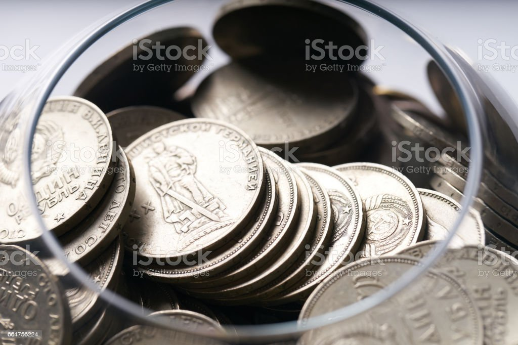 piggy bank opened and filled with Soviet silver coins stock photo