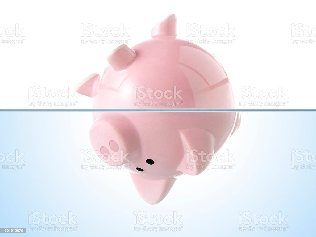 Piggy bank sinking in water. Concept image. stock photo