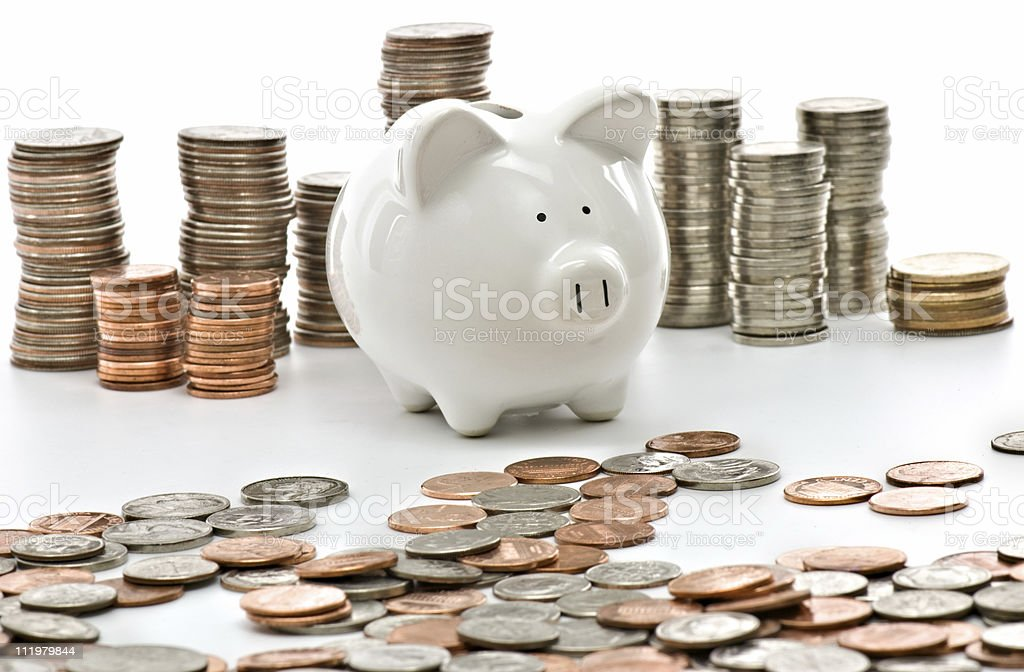 Piggy Bank Surrounded with Stacks of US Coins royalty-free stock photo