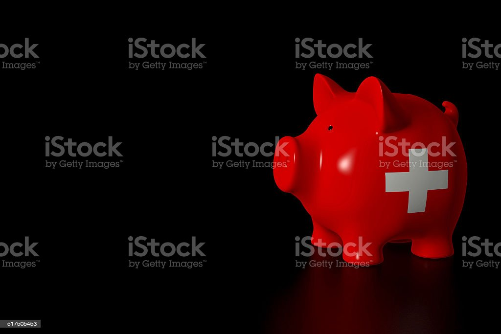 Piggy bank - swiss flag stock photo