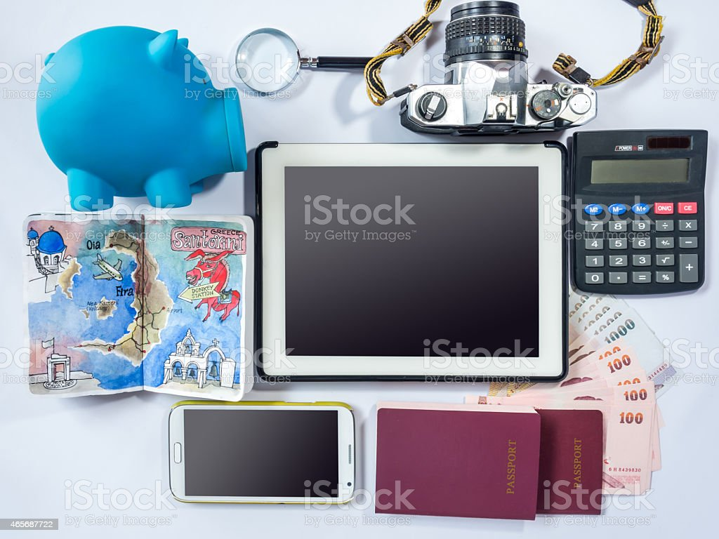 Piggy bank, tablet, smart phone, passport book/ dream destination concept stock photo