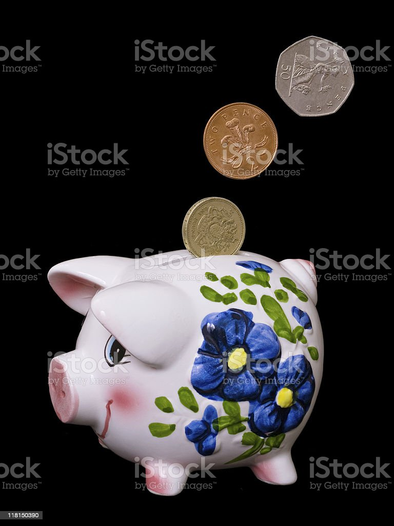 Piggy Bank - UK Coins royalty-free stock photo