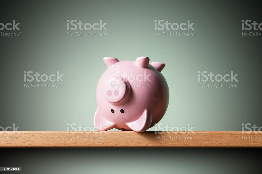 Piggy bank upside down stock photo