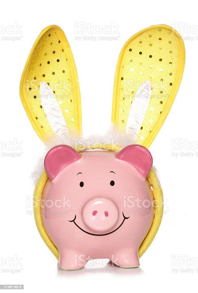 Piggy bank wearing easter bunny ears stock photo