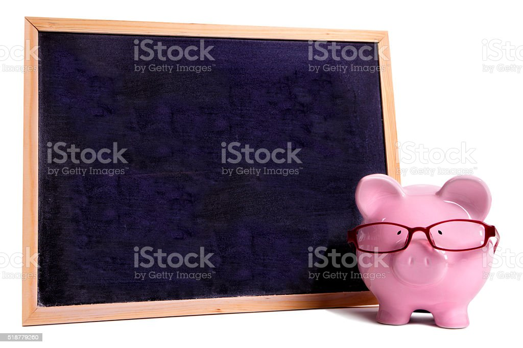 Piggy bank wearing glasses with small blank blackboard, isolated stock photo