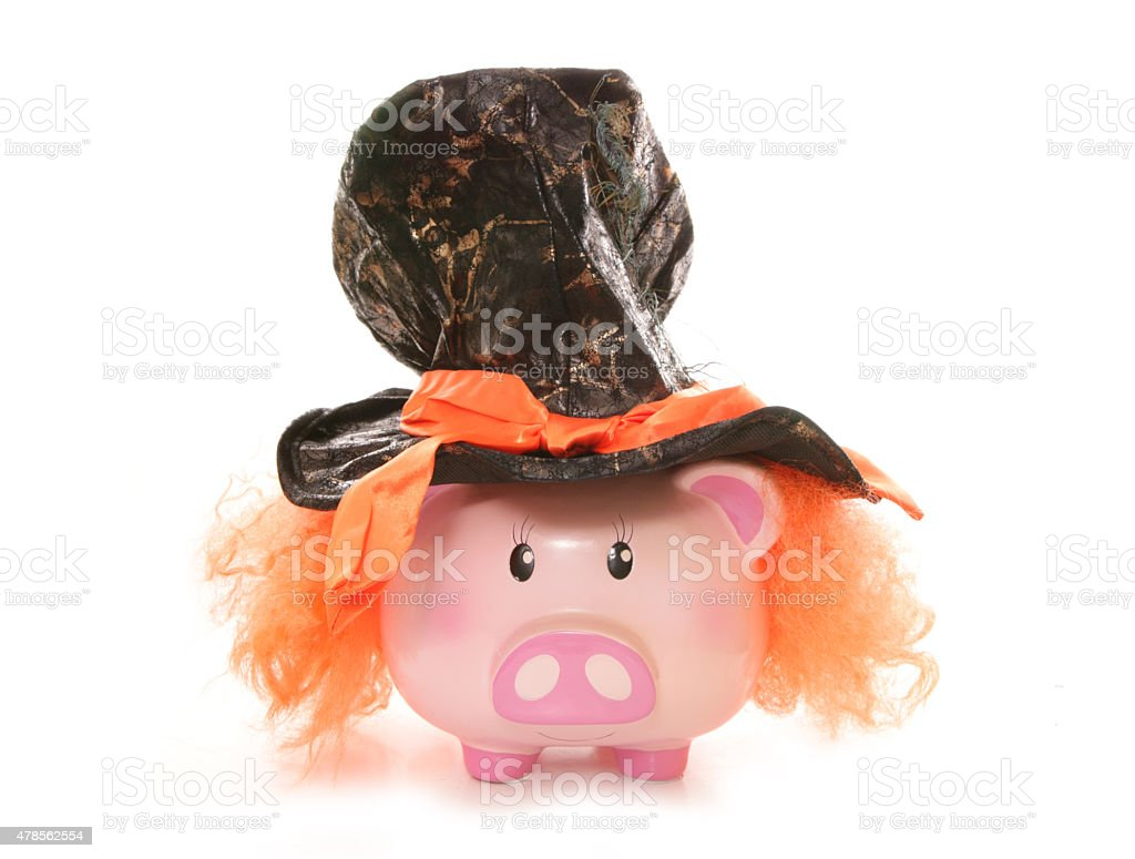 piggy bank wearing mad hatter hat stock photo