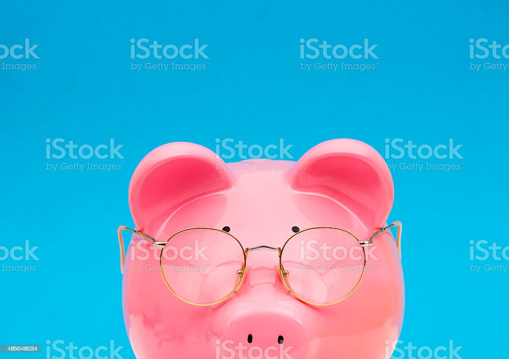 Piggy Bank Wearing Reading Glasses stock photo