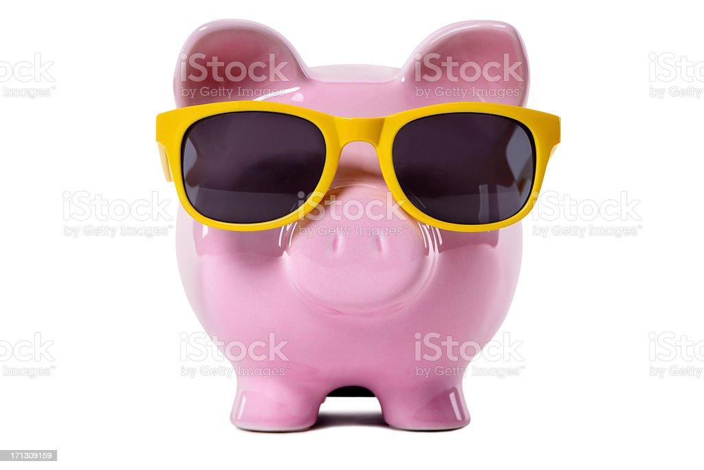 Piggy Bank wearing yellow sunglasses royalty-free stock photo