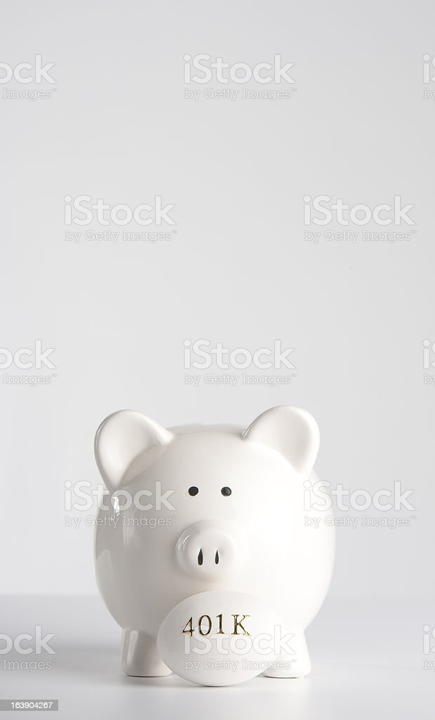 Piggy bank with 401k nest egg royalty-free stock photo