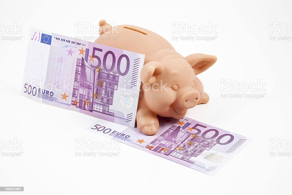 Piggy bank with 500 euros bills royalty-free stock photo