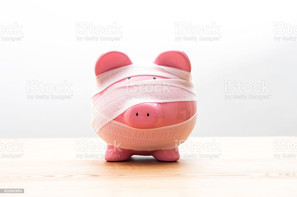 Piggy Bank With Bandages stock photo