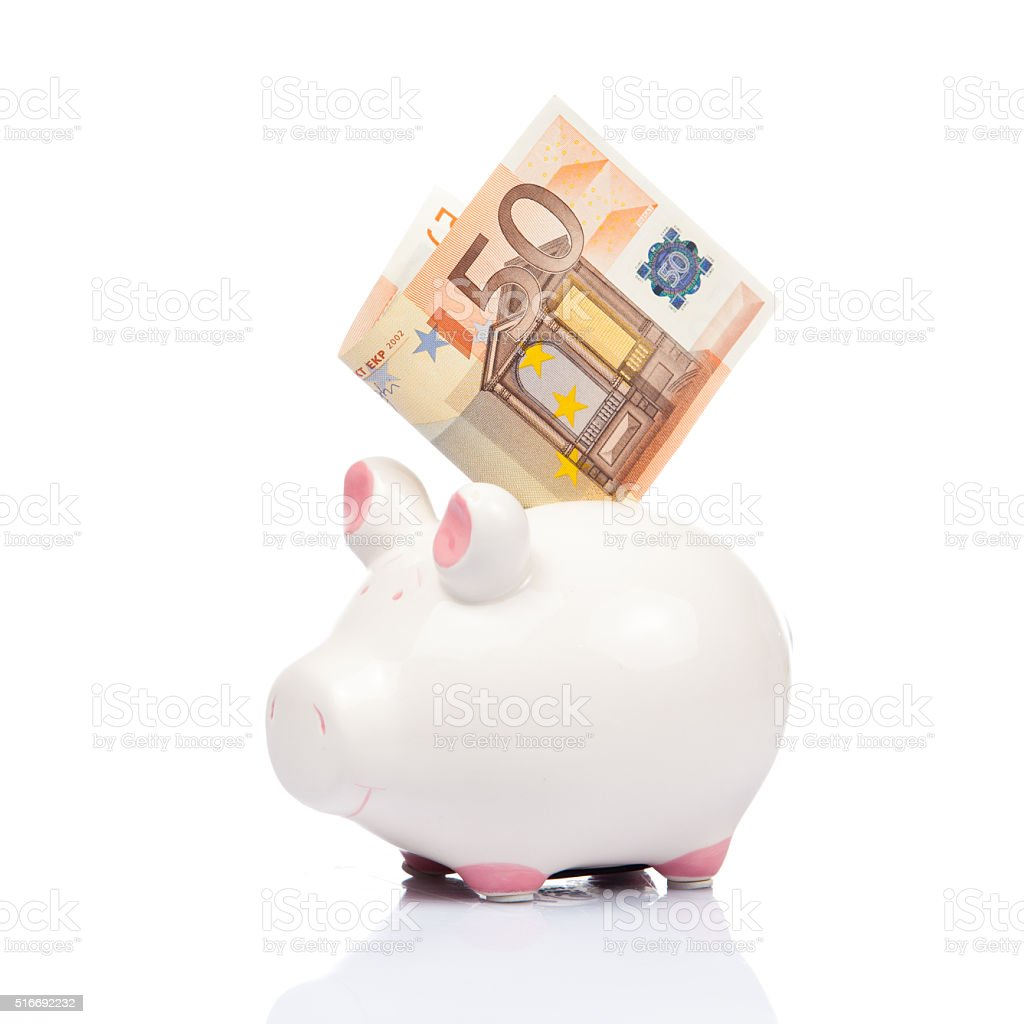 Piggy bank with banknote. stock photo