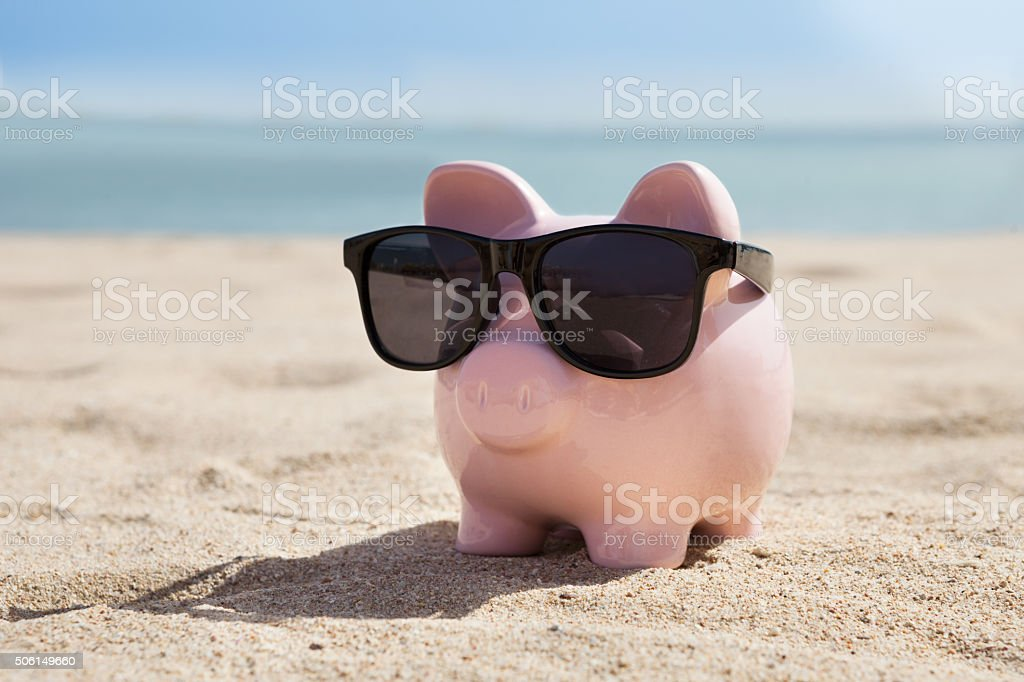 Piggy Bank With Black Sunglasses stock photo