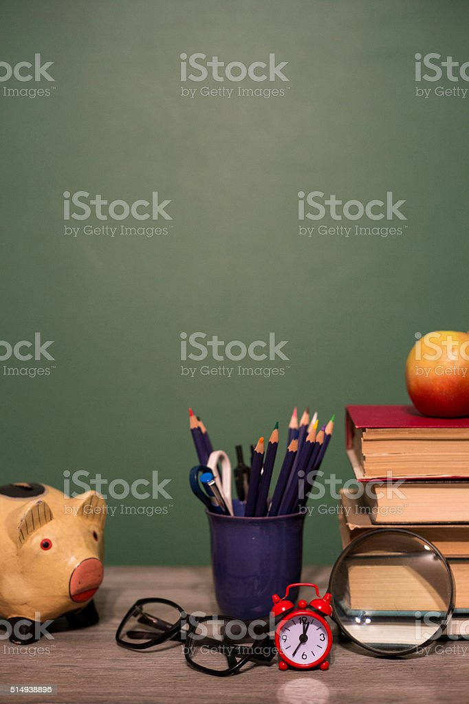 Piggy Bank with books stock photo