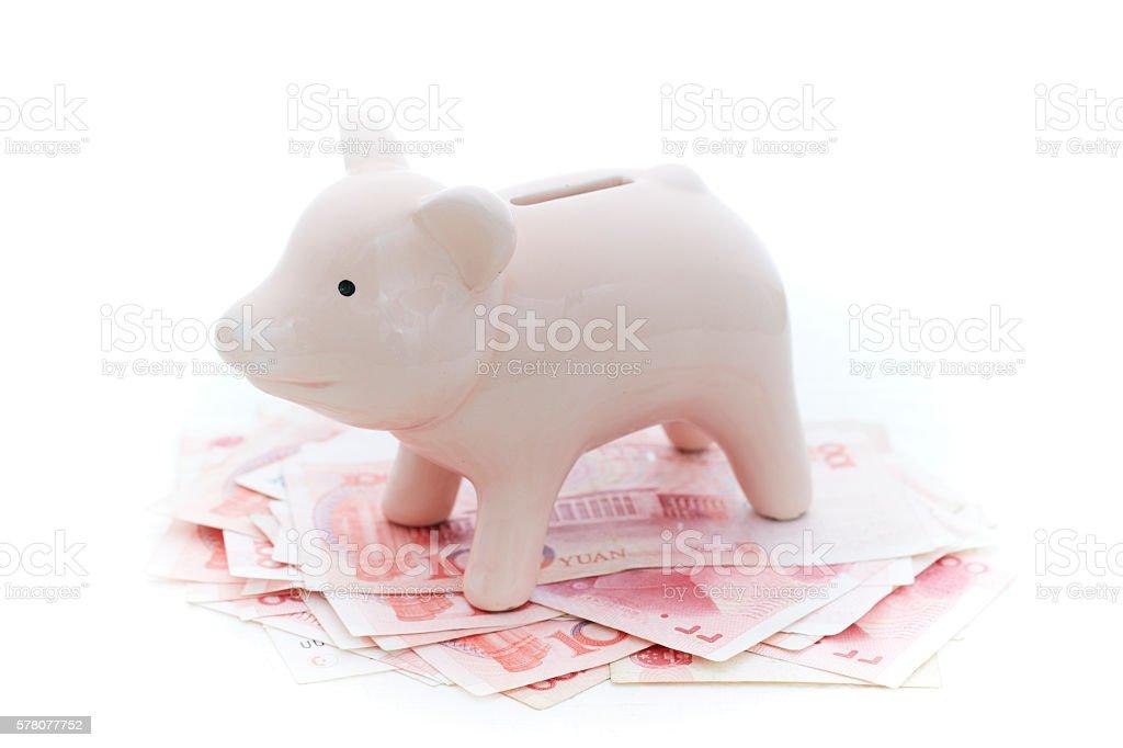 Piggy bank with Chinese RMB bills stock photo