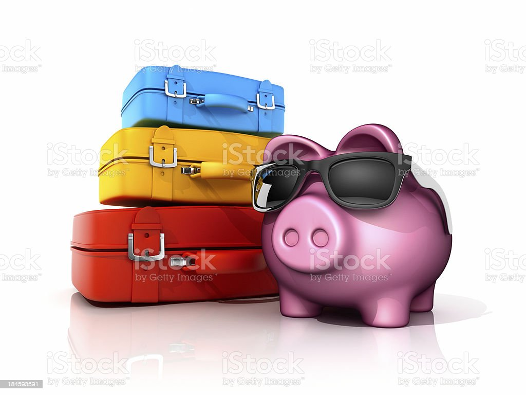 Piggy bank with colorful suitcases royalty-free stock photo