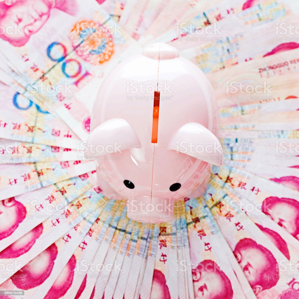 Piggy bank with currency stock photo