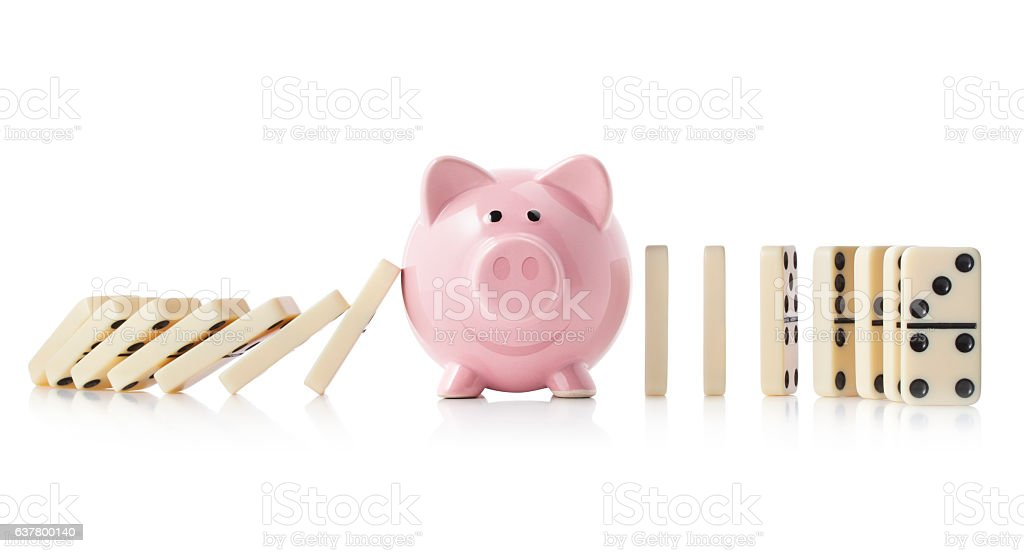 Piggy bank with dominoes stock photo