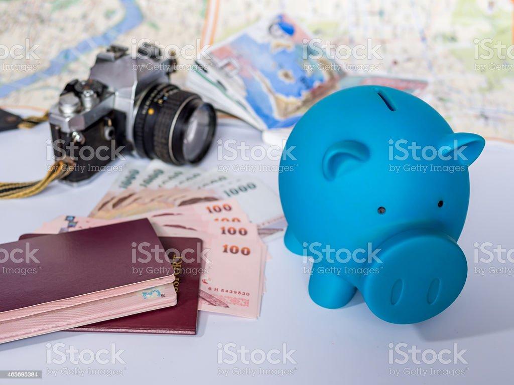 Piggy bank with dream destination sketch, passport book/  saving concept stock photo