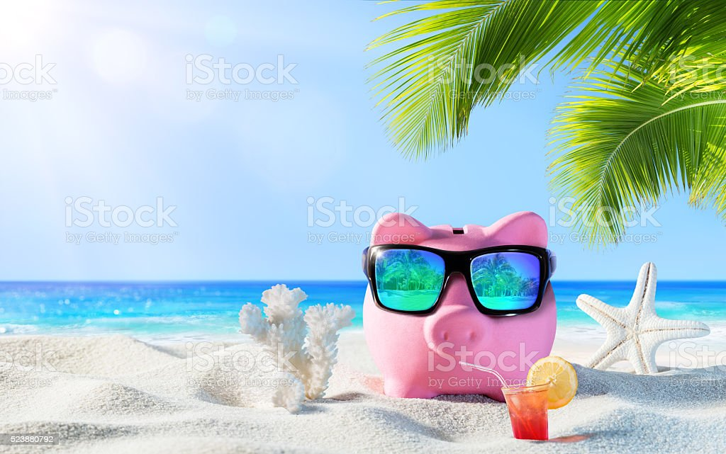 Piggy Bank With Drink On The Palm Beach stock photo