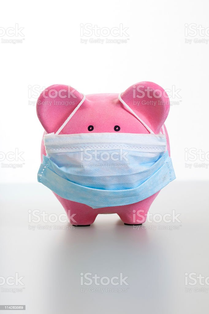 Piggy Bank with Face Mask - Swine Flu Concept stock photo