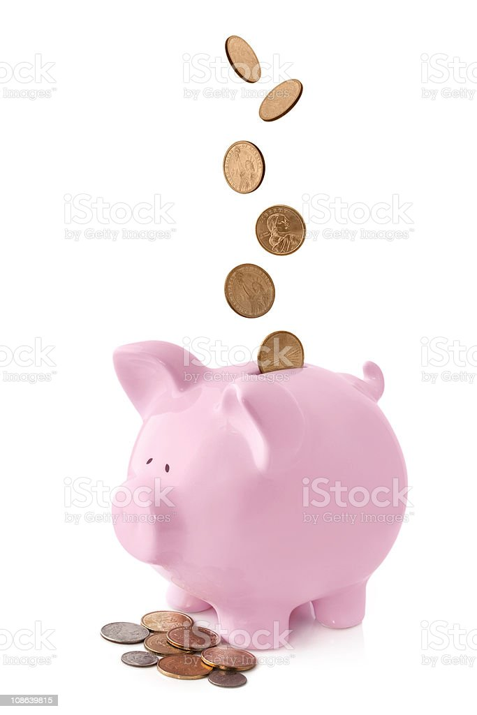 Piggy Bank with Falling Coins stock photo