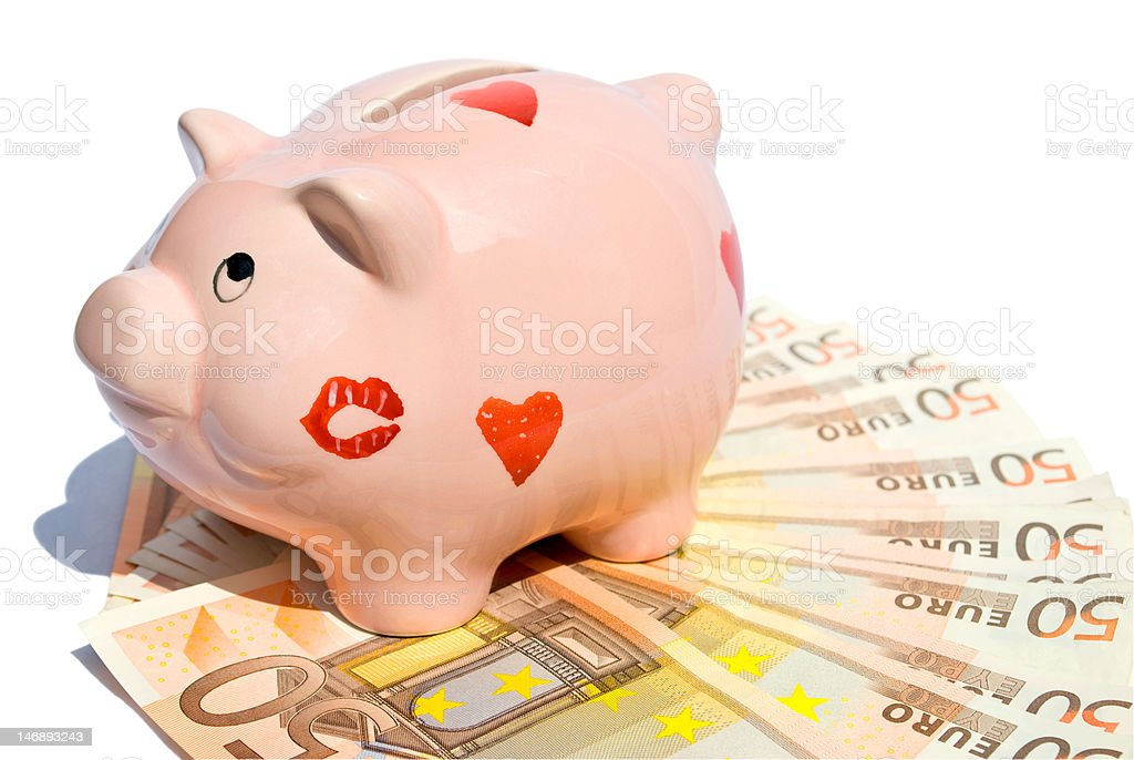 Piggy bank with fifty euro notes royalty-free stock photo
