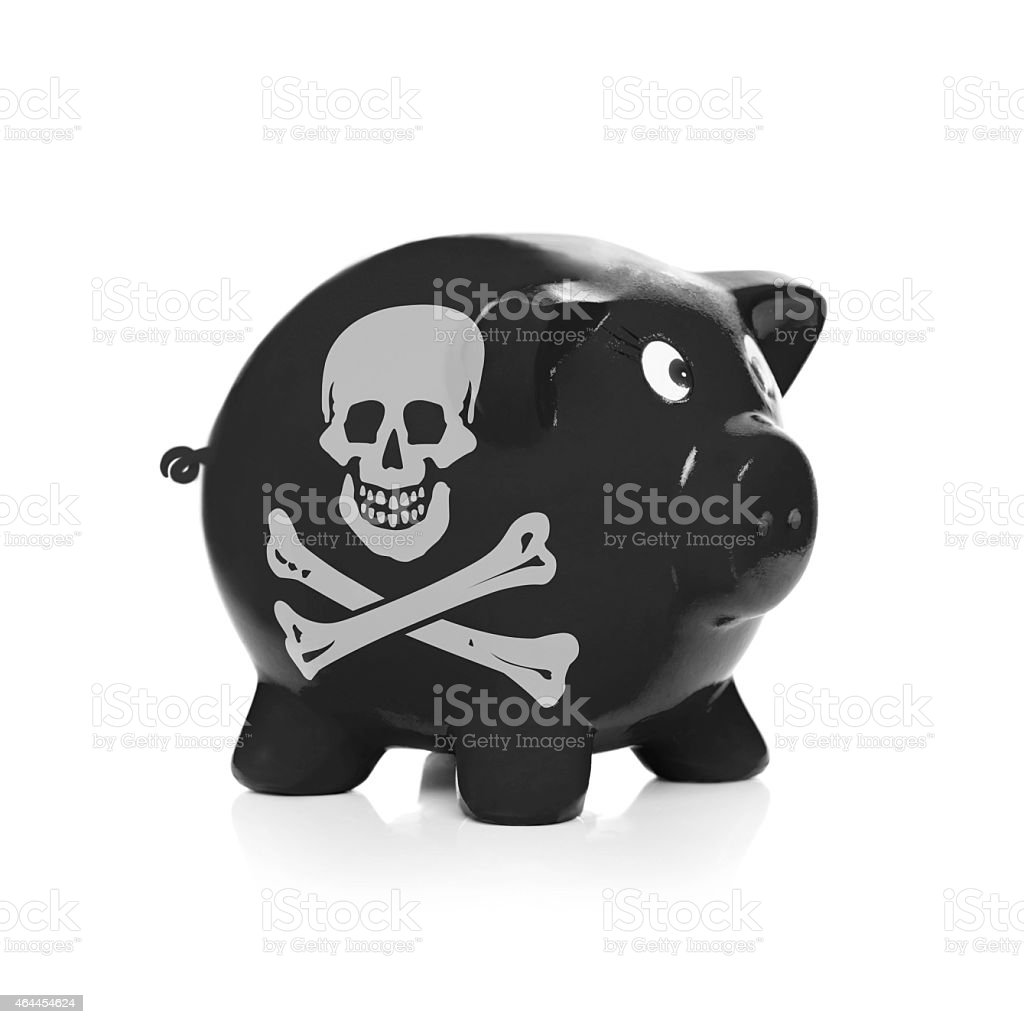 Piggy bank with flag coating over it - Jolly Roger stock photo
