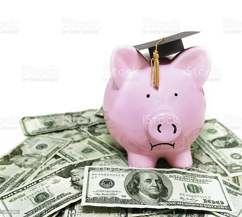 piggy bank with graduation cap royalty-free stock photo
