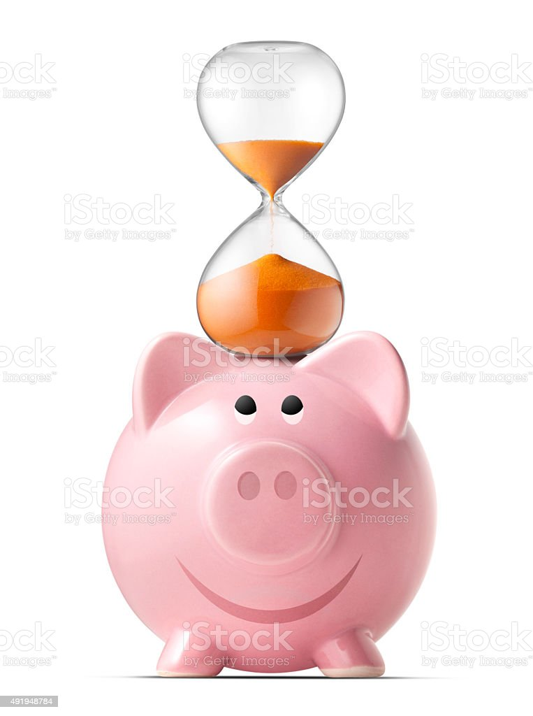 Piggy bank with hourglass stock photo