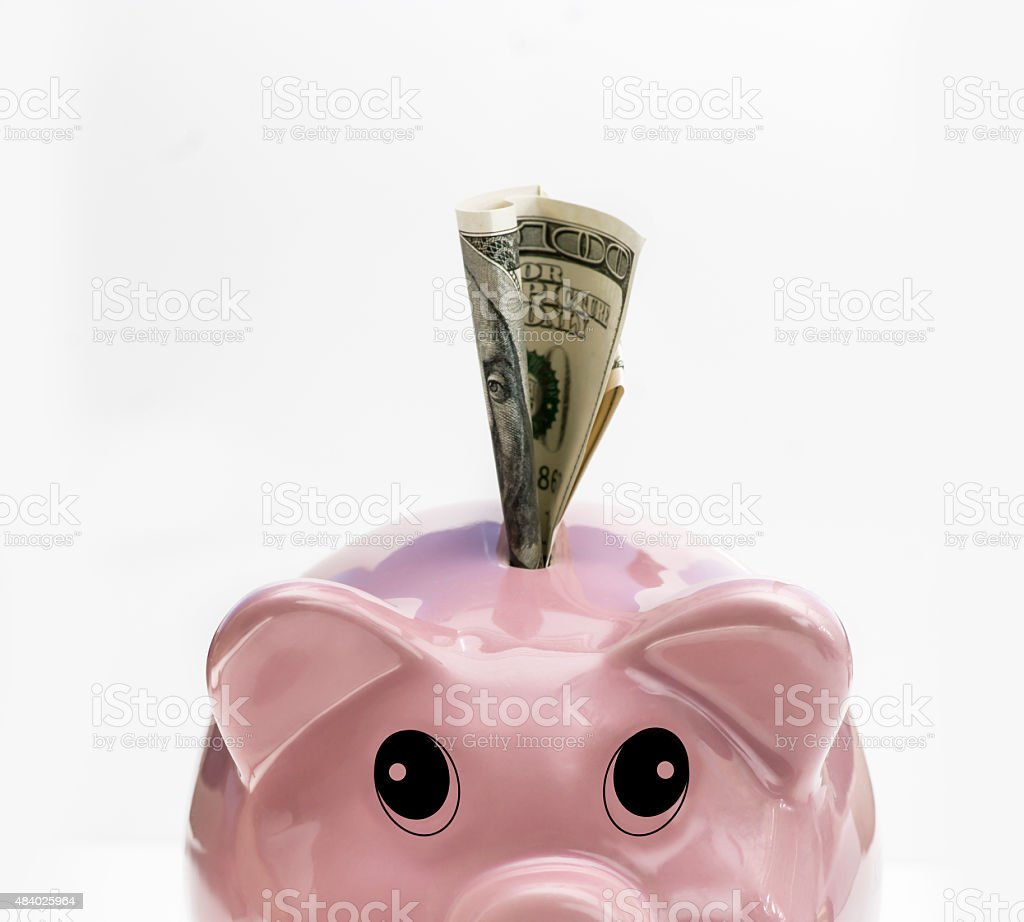 Piggy Bank with hundred dollar bill stock photo