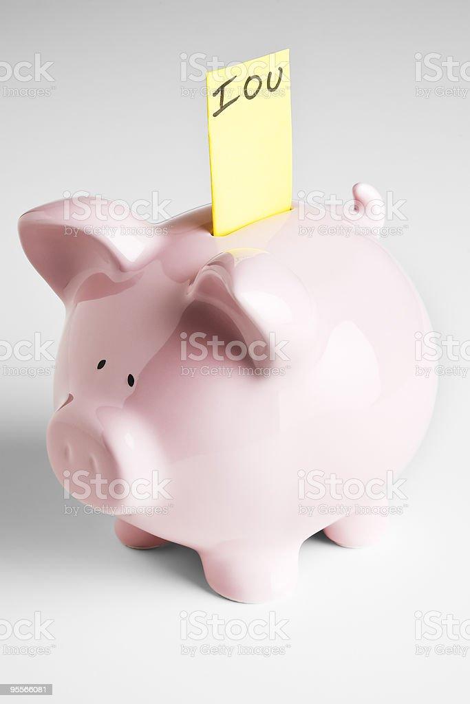 Piggy bank with IOU stock photo