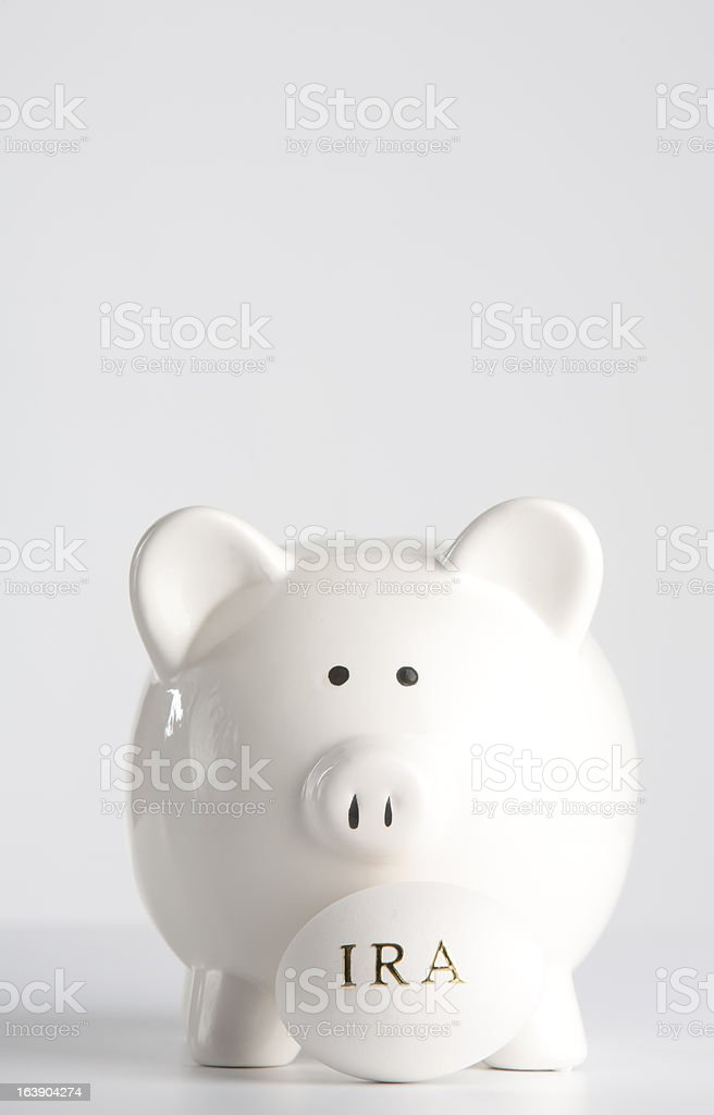 Piggy bank with IRA nest egg royalty-free stock photo