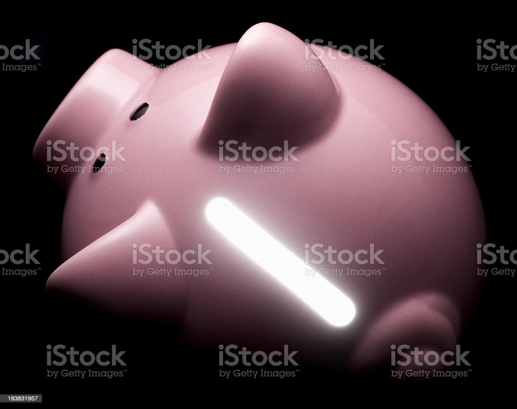 Piggy bank with light coming from the inside royalty-free stock photo