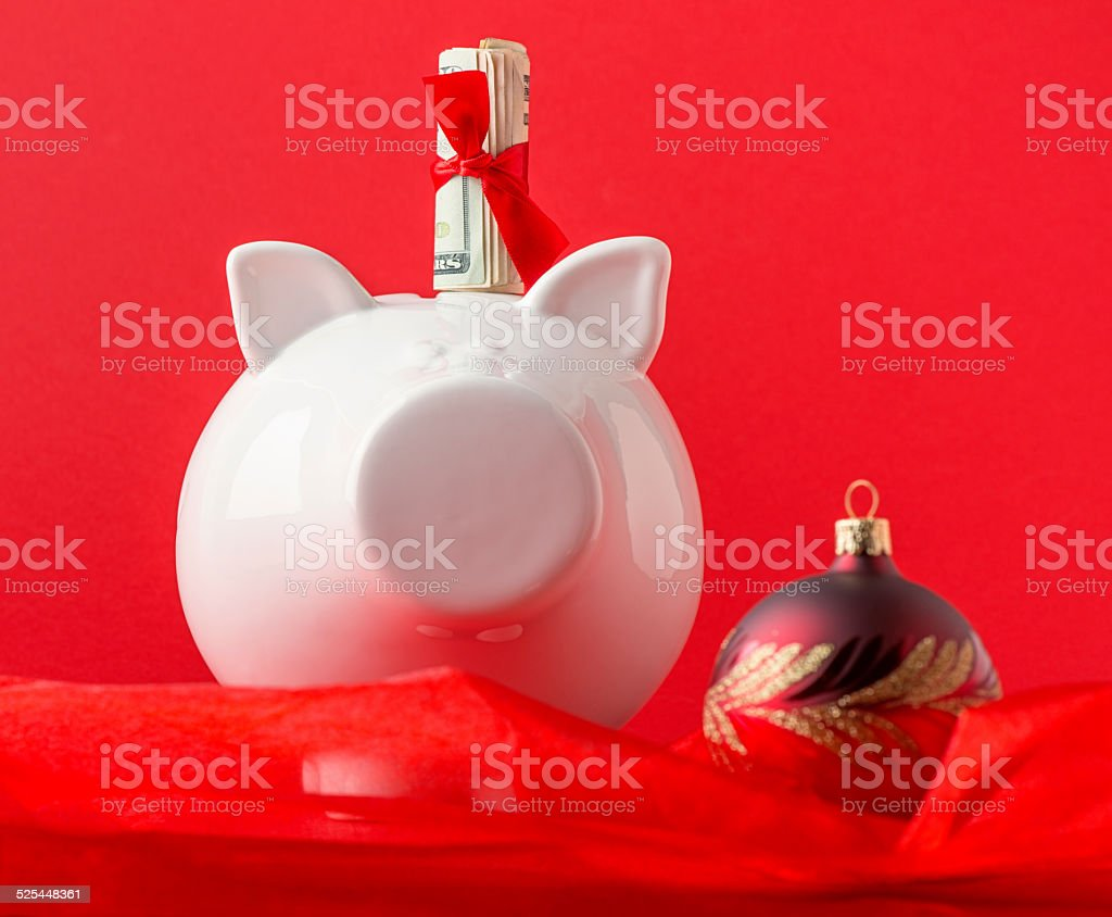 Piggy Bank with Money Roll And Red Xmas Bauble stock photo