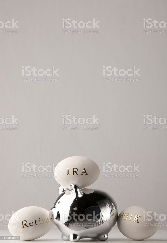 Piggy bank with nest eggs for retirement royalty-free stock photo
