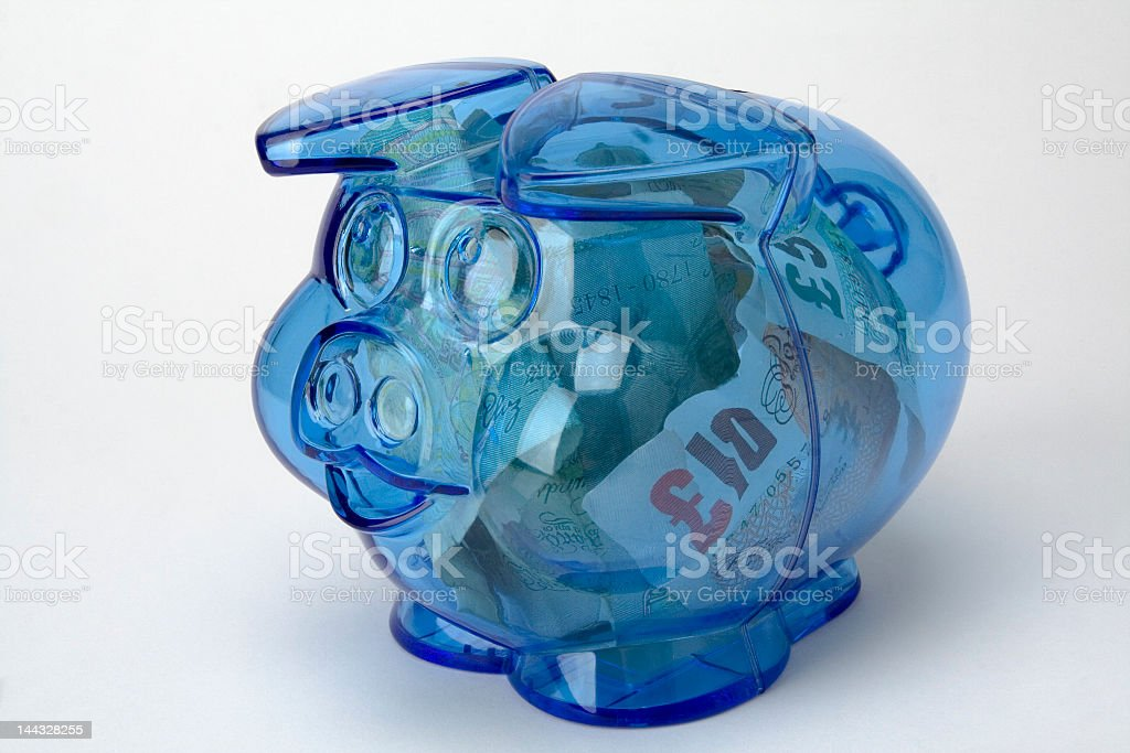 Piggy bank with pound notes money stock photo