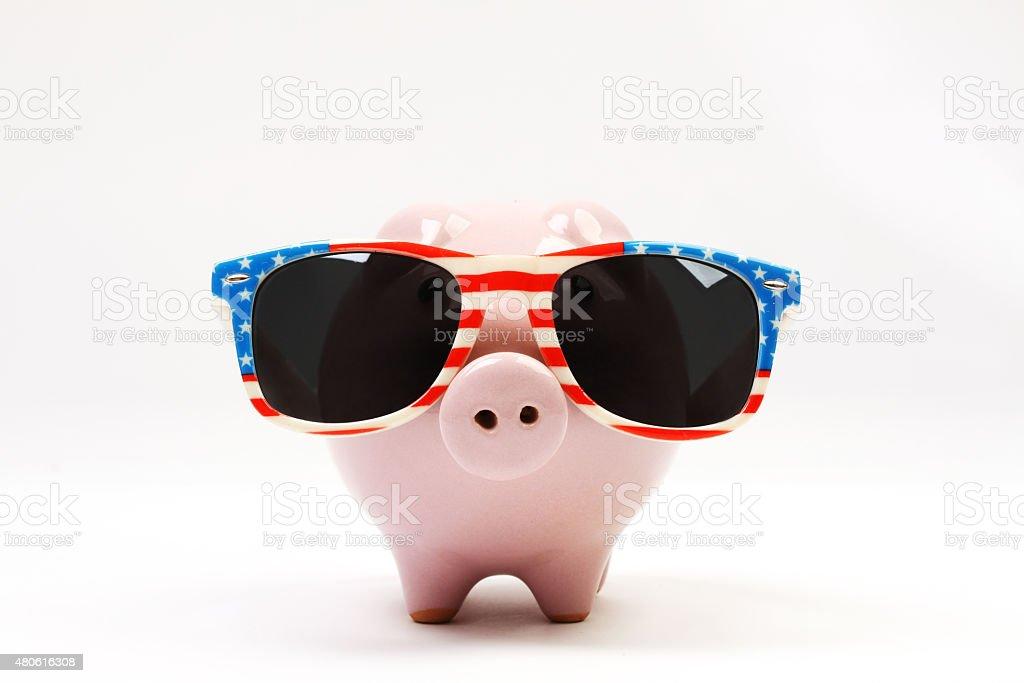Piggy bank with retro sunglasses with USA flag stock photo