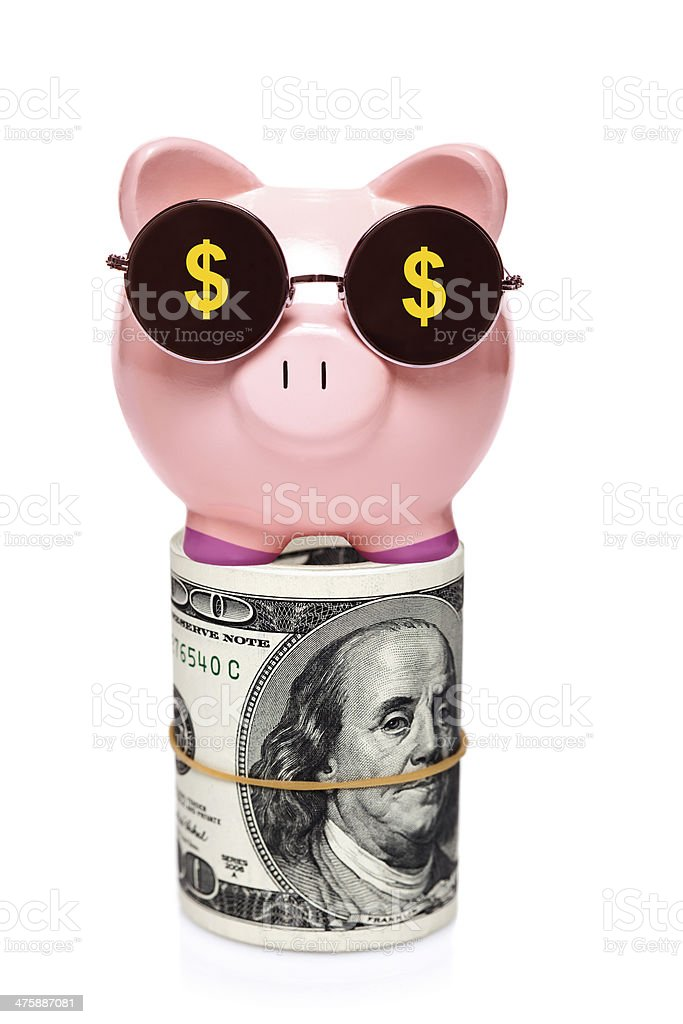 Piggy bank with  roll of $100 bills stock photo