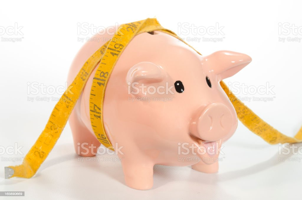 Piggy Bank with Squeezed Savings royalty-free stock photo