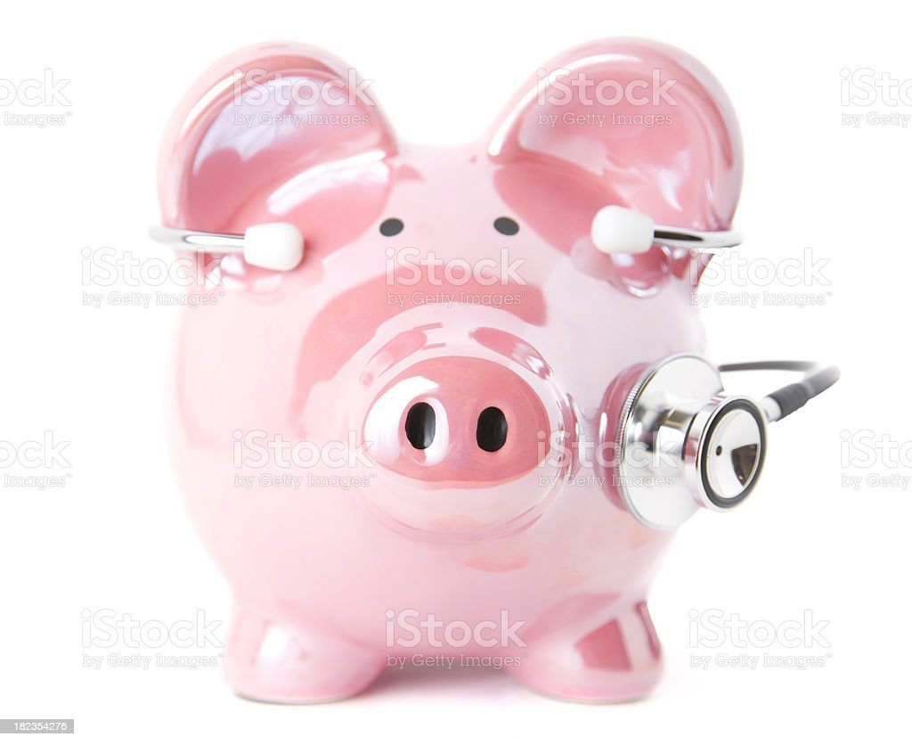 Piggy Bank with Stethoscope On stock photo
