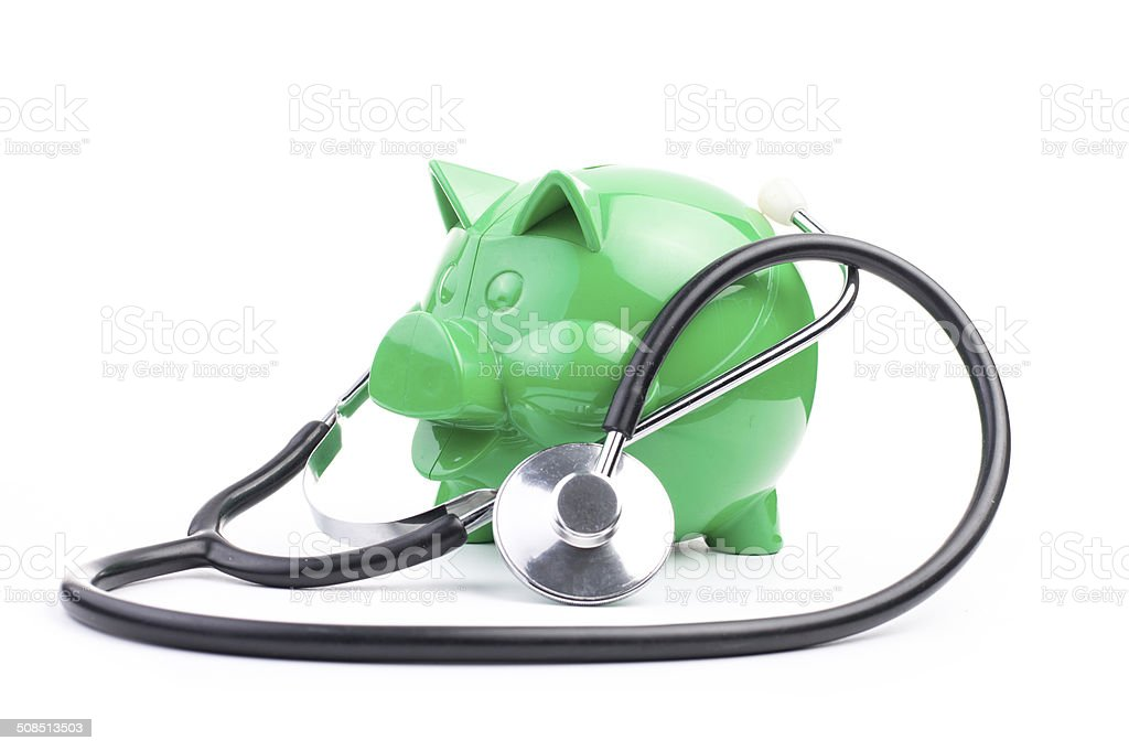 Piggy Bank With Stethosope stock photo