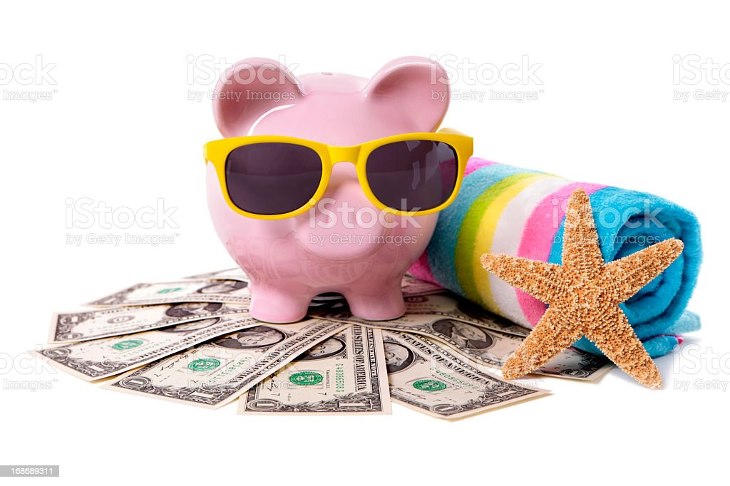 Piggy bank with sunglasses going to the beach on vacation stock photo