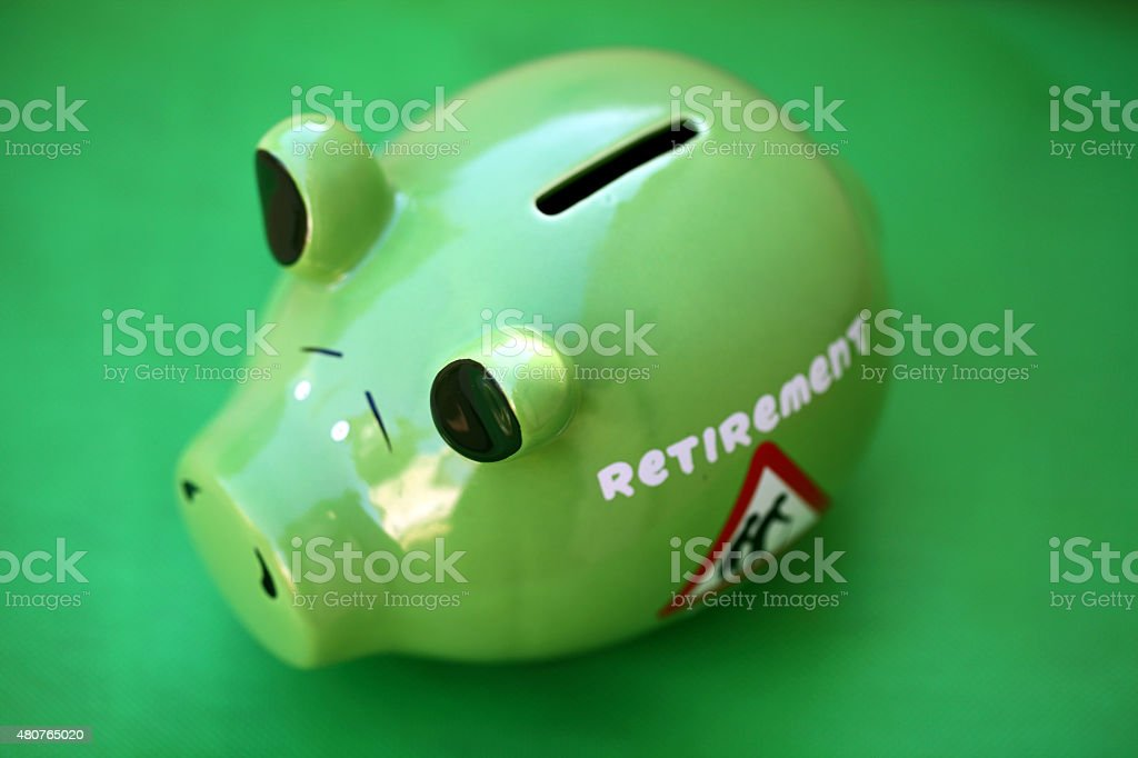Piggy bank with sunset light - money concept stock photo