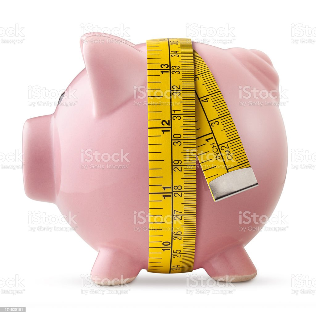Piggy bank with tape measure royalty-free stock photo