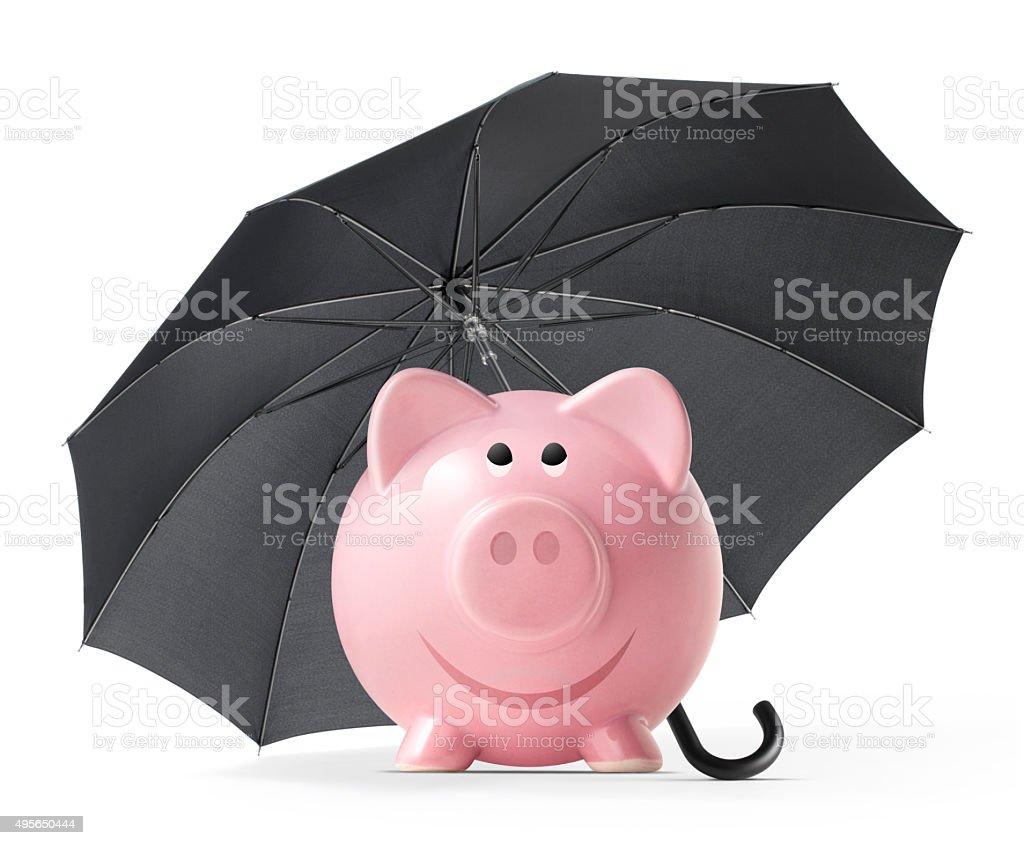 Piggy bank with umbrella stock photo