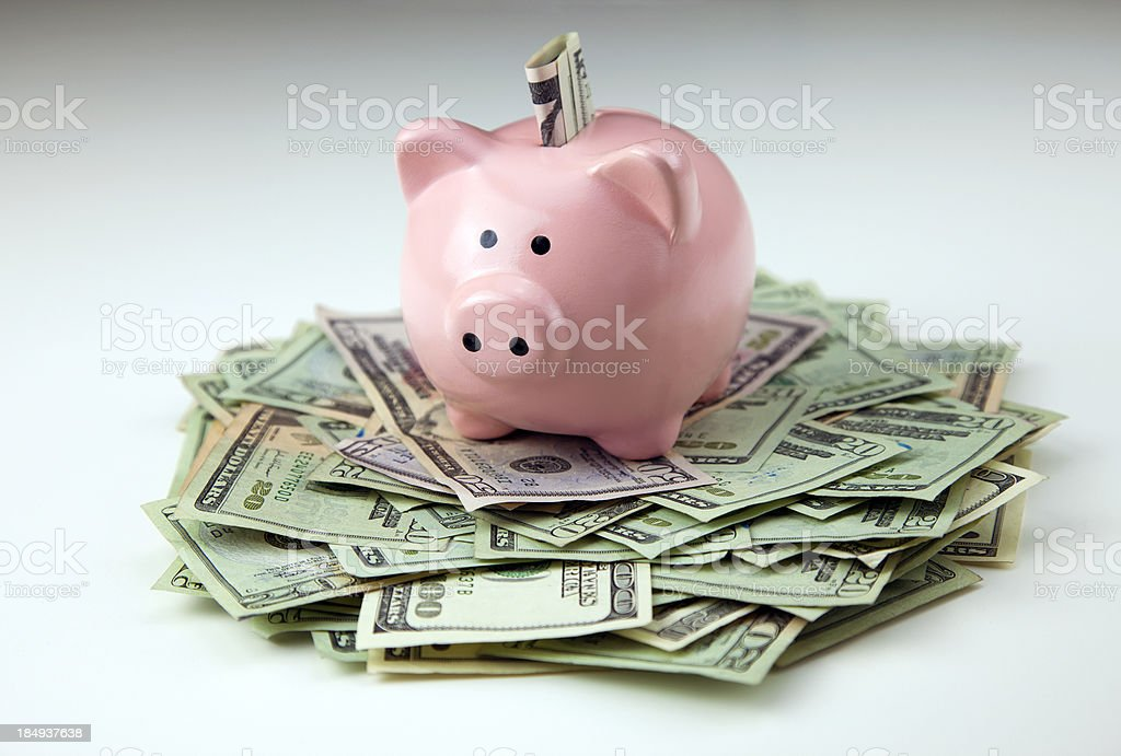 Piggy bank with us currency. stock photo